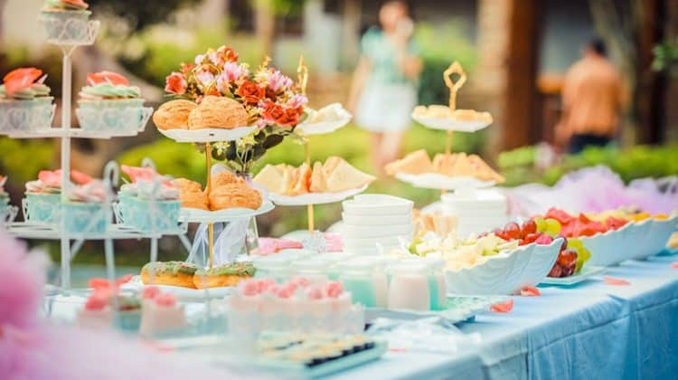 White Steel Cupcake Stand with colourful cupcakes prepared by catering service