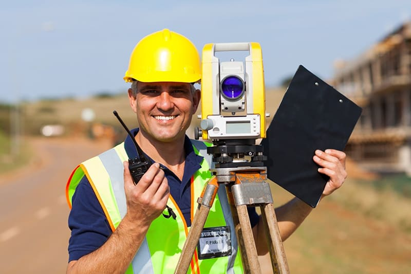 Professional surveyor - land surveyor with equipment