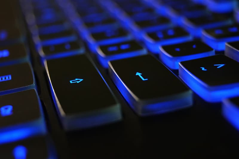 close up of blue and black computer keyboard