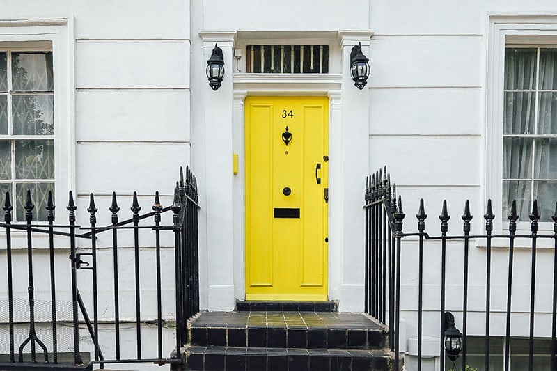 Leasehold property with yellow front door