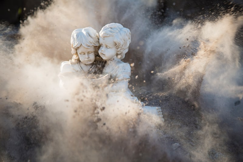 angelic statues covered in dust