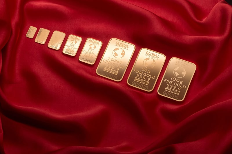 Precious metals - gold bars on red cloth