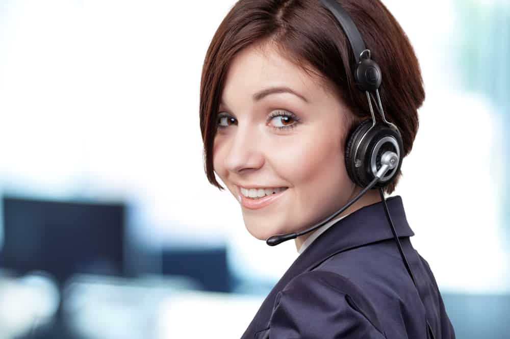 Woman wearing headset in contact  centre