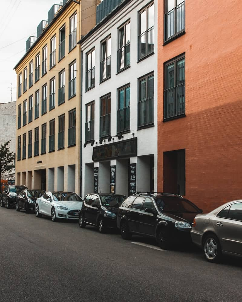 Fleet of parked cars outside a building