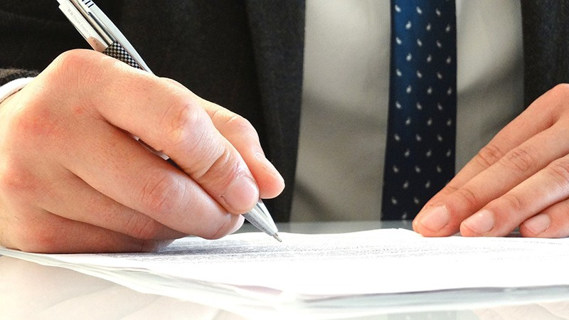 legal attorney signing papers