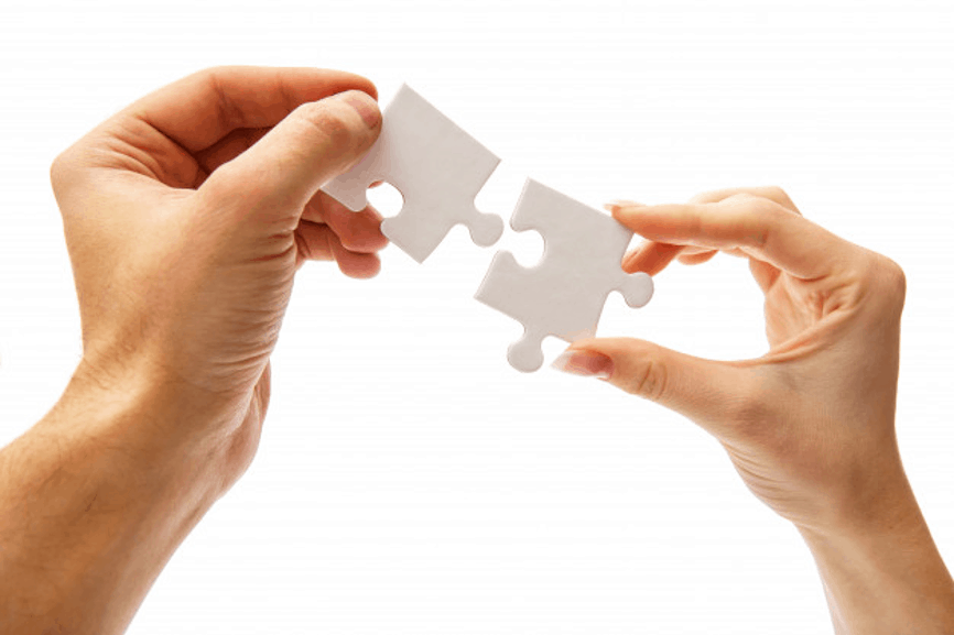People putting pieces of a puzzle together - business strategy