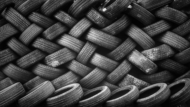 Piles or tires rubber stacked used tyres