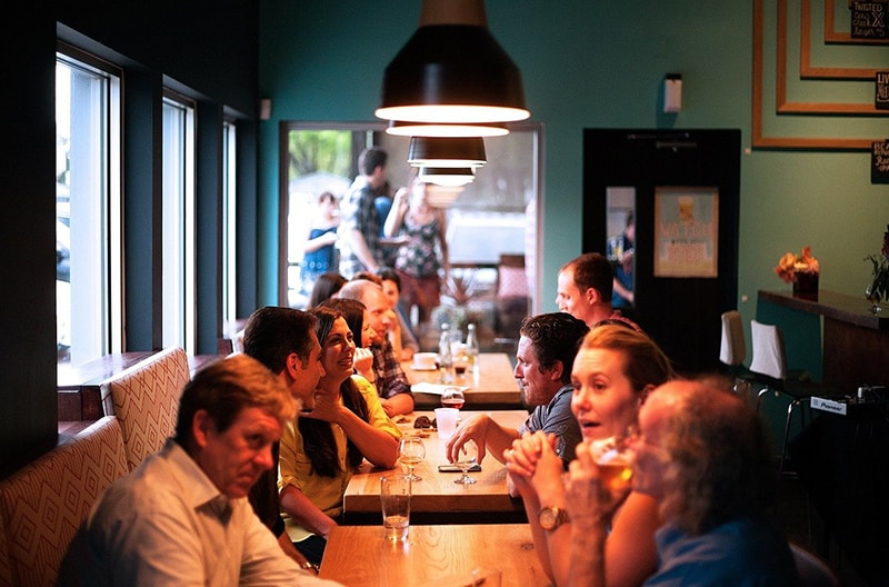 people sitting in restaurant eating and drinking