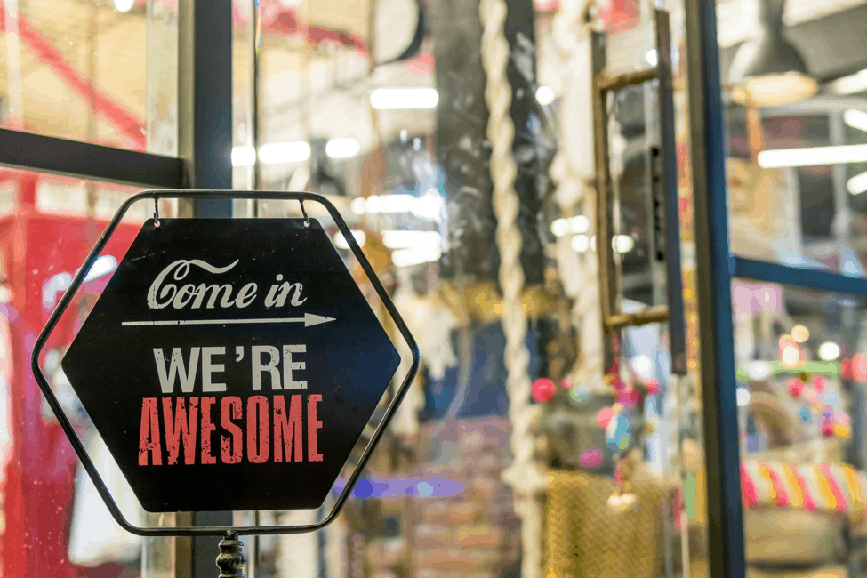 come in we're awesome sign in shop window