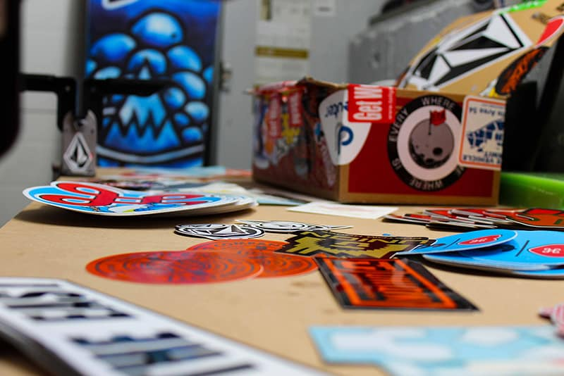 selection of custom vinyl stickers on table