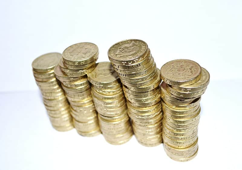 stacks of pound coins sterling - fiscal sponsorship funding