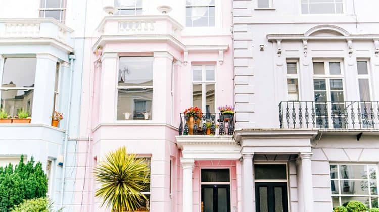architectural photography of white and pink town house buildings