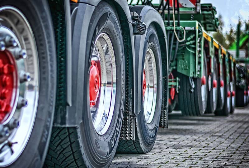 close-up image of wheels of heavy-duty lorry – truck – commercial vehicle – lorry business