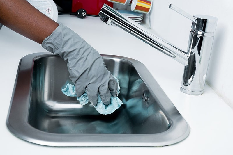 cleanliness, person cleaning kitchen sink, cleaning