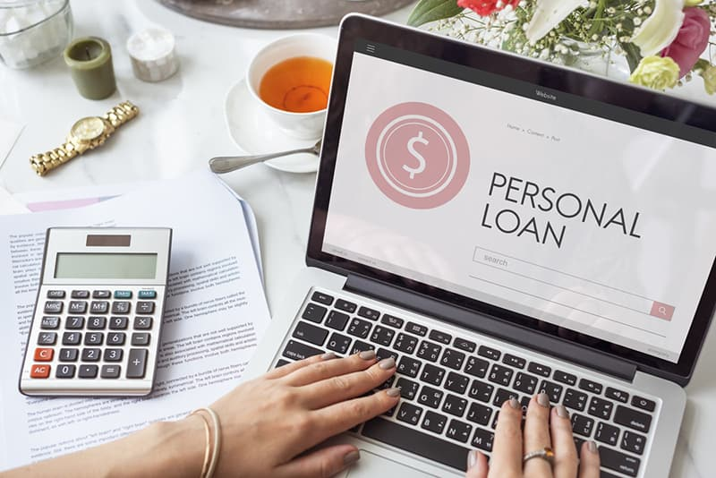 Person applying for a personal loan on laptop