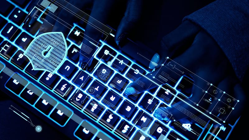 Closeup of hands using a keyboard – cyber security cyber crime - white collar crime