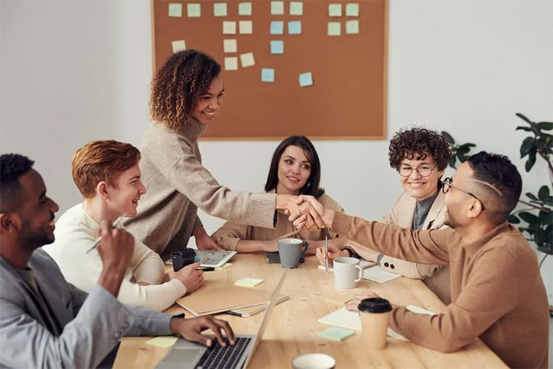 A group of people in a conference table