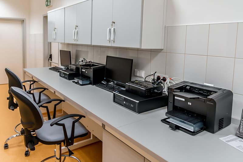 office equipment on worktop - including printers, monitors and  computers