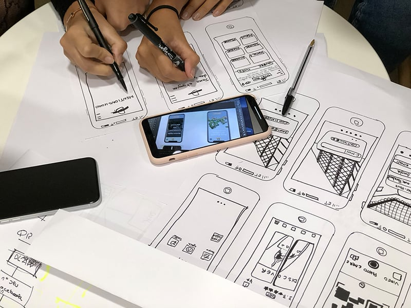 two app developers working on mobile app design – digital solutions and applications