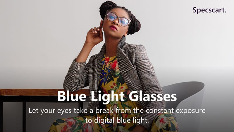 A woman wearing blue light glasses