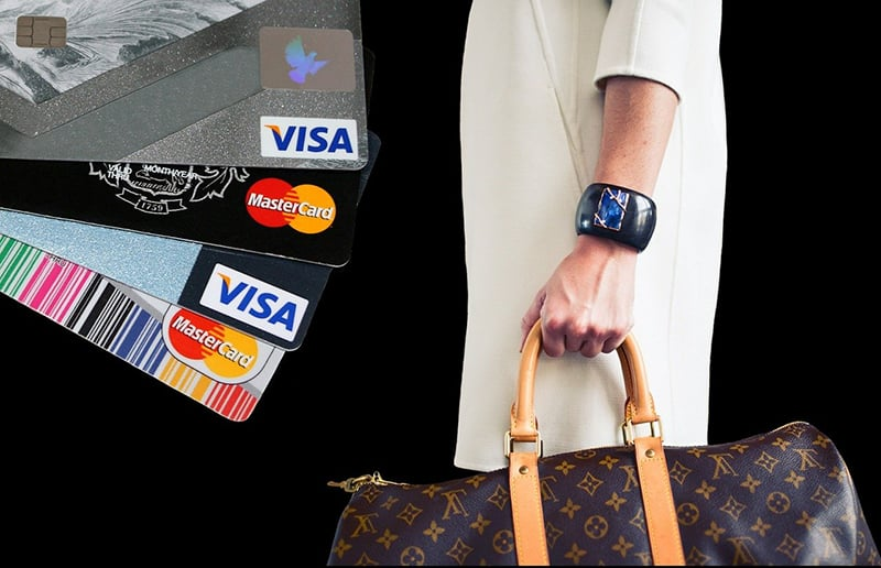 credit cards and someone holding bag
