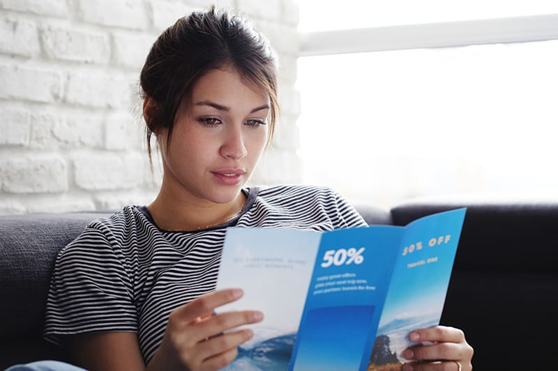 Woman reading a well-designed flyer