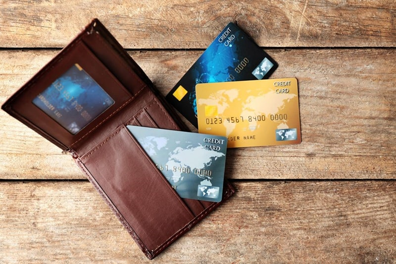 Credit cards and wallet on wooden table