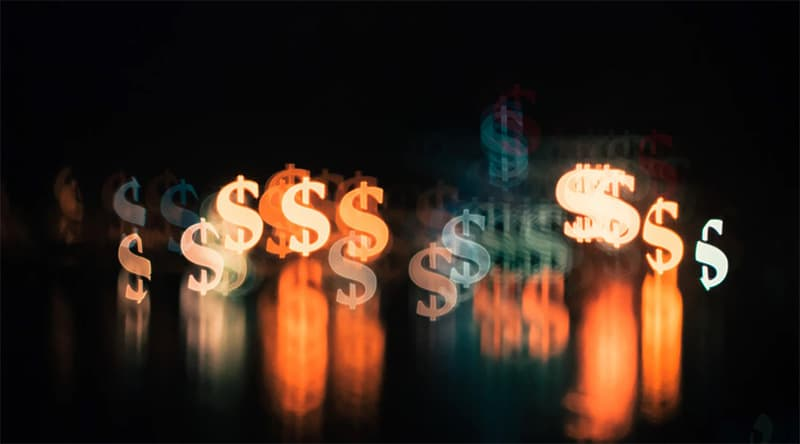 A colorful dollar symbols with black background