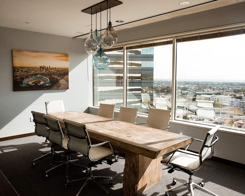 A conference table near the window views the city