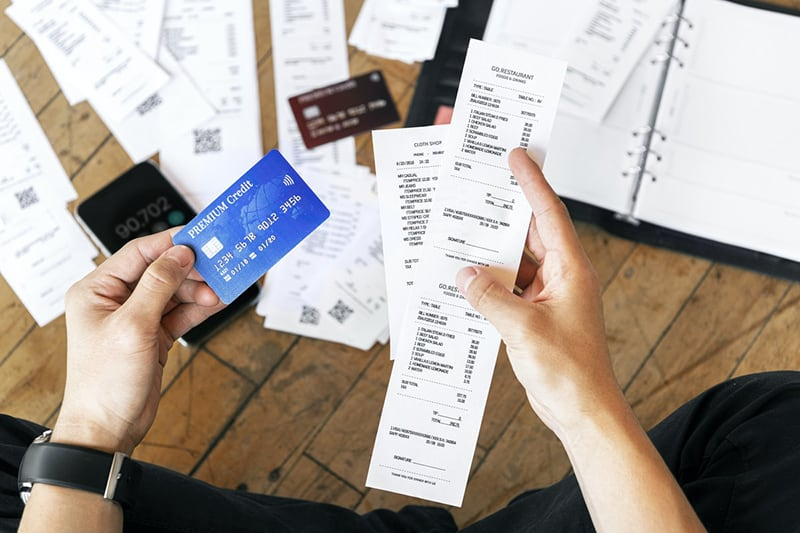 man keeping track of his expenses and digital bank transactions