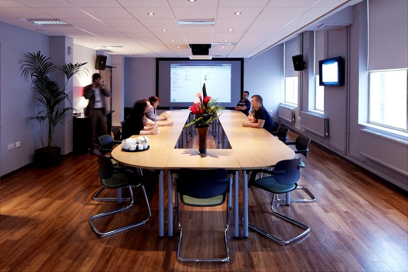 People sat around a conference table in meeting room