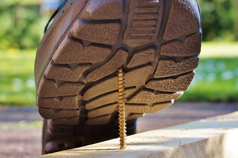 personal injury at work – about to step on screw sticking out of a piece of wood
