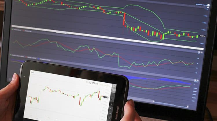 Forex trading analysis forex chart on the laptop and tablet screen