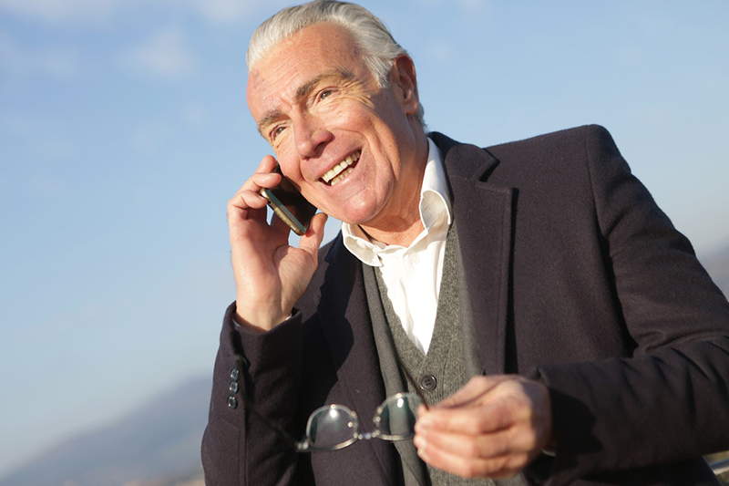 senior executive – mature businessman having a conversation on smartphone in city