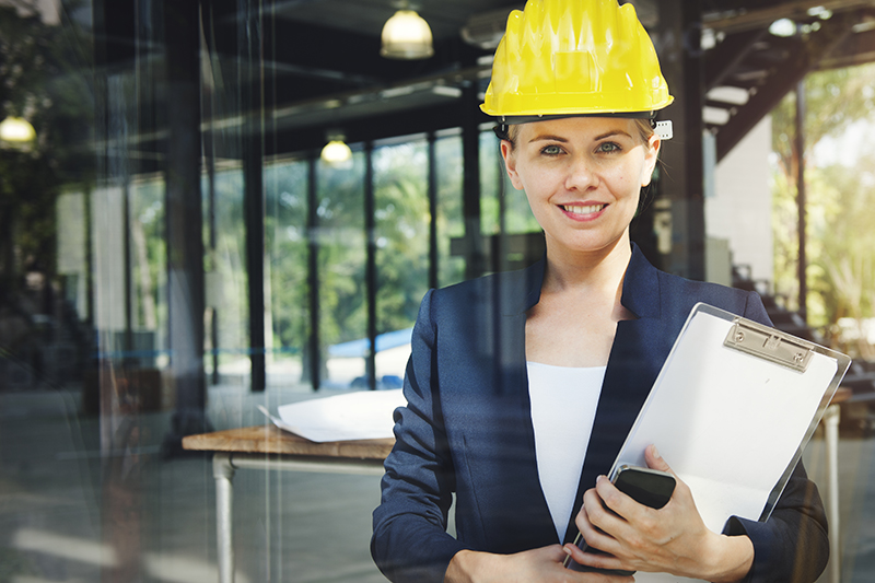 Woman engineer wearing hard hat in site constrauction