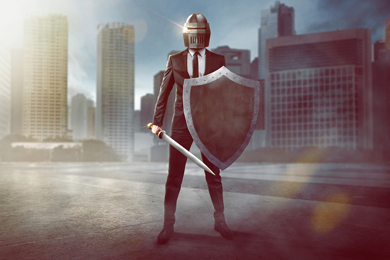 Business man in suit prepared for unexpected risk with sword, shield and helmet
