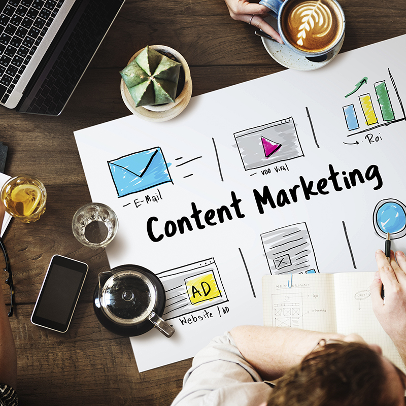 A man creating a content marketing plan in the table