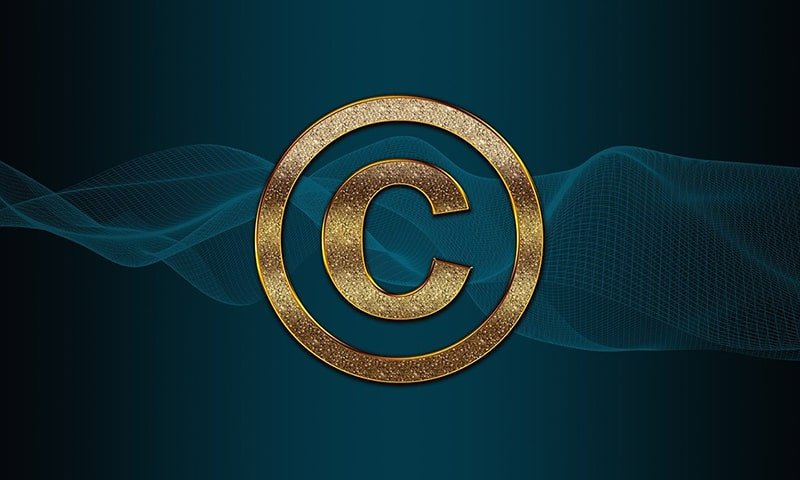 Gold copyright symbol set against teal background