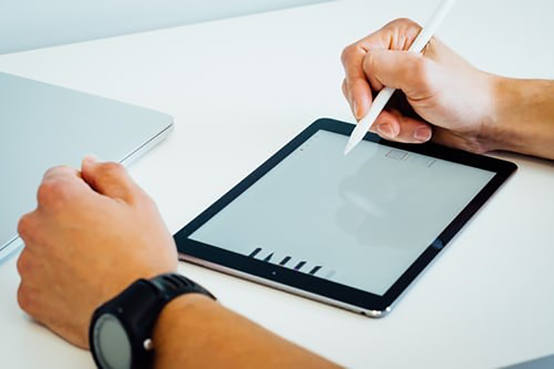 Person using merchant portal on tablet computer