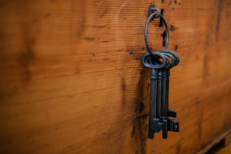 Keys hang in the wooden wall