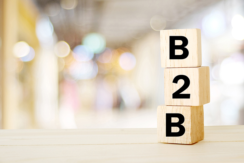 B2B , business to business marketing, business word on wooden cubes over blur background