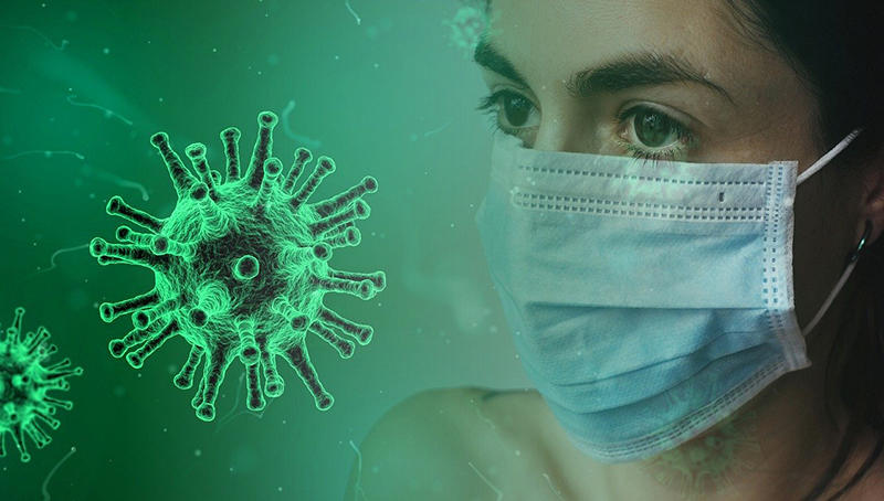 Covid-19 - coronavirus – virus – mask – person wearing mask in the workplace