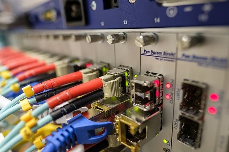 Close-up of Fibre Optic andethernet cables connecting to a router