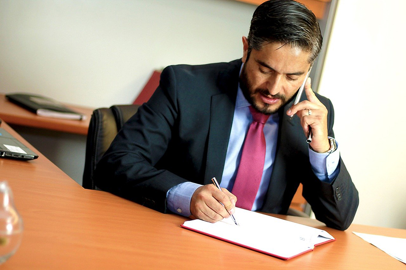 Insurance lawyer settling an insurance claim on the phone