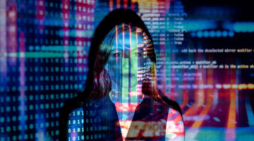 code projected over a woman – custom software development