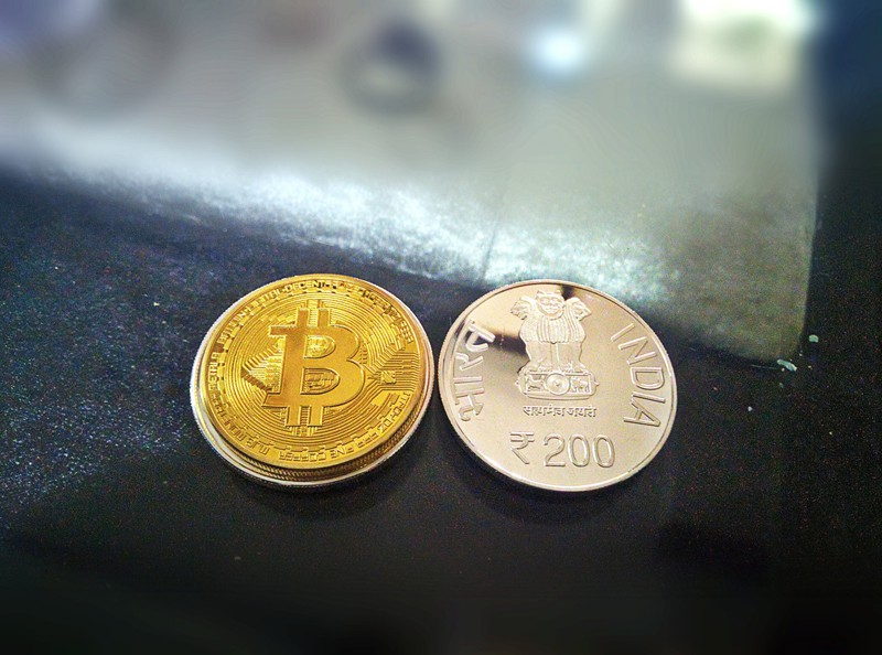 2 coins on a table - bitcoin and Indian Rupee