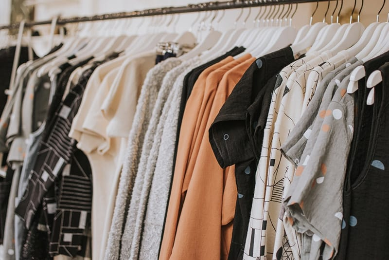Rail of clothing for sale in store