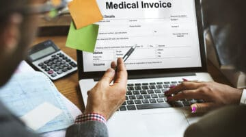 Patient Medical Invoice - medical billing document on laptop screen