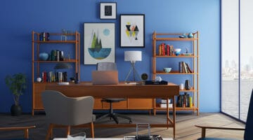brown wooden desk with rolling chair and wooden shelves