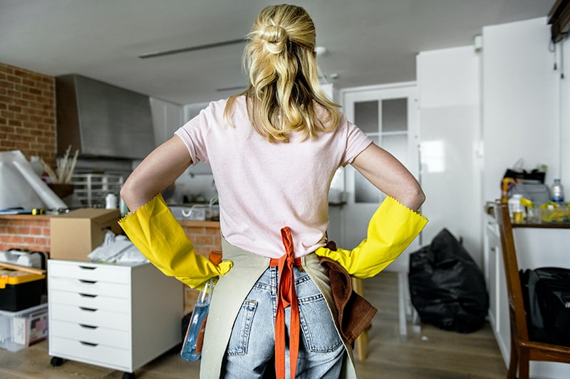Woman wearing yellow gloves and apron
